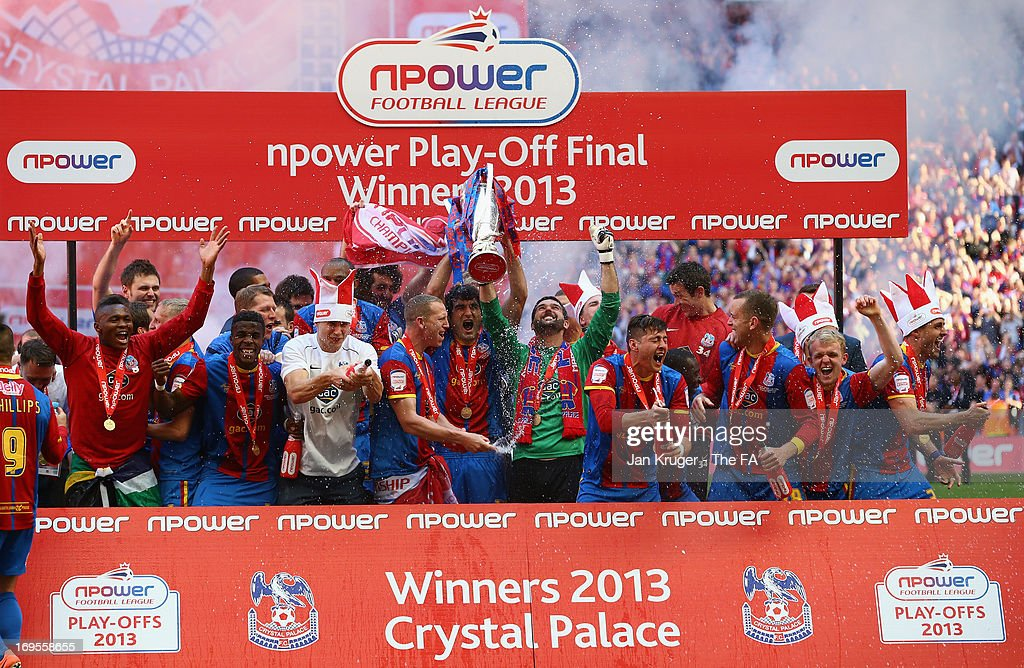 The Crystal Palace players celebrate with the trophy following their victory in extra-time to clinch promotion during the npower Championship Play-off Final match between Watford and Crystal Palace at Wembley Stadium on May 27, 2013 in London, England.