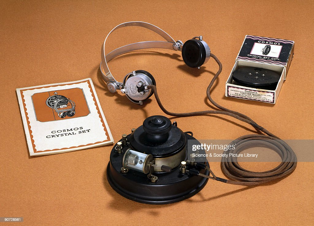 The crystal radio set was simple and cheap. It consisted basically of a tuned circuit and a crystal detector, and had no batteries, the power delivered to its headphones all coming from the transmitter. Most designs, as here, used a wire �cat�s whisker� touching a favourable spot on the crystal at just the right pressure. The slightest vibration, such as slamming a nearby door, could lose the programme being listened to altogether until patient adjustment brought it back.