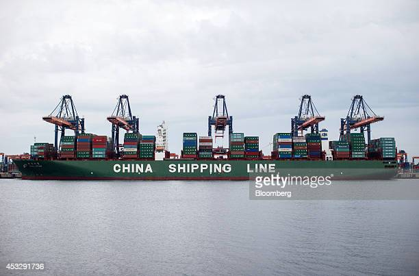 The CSCL Star container ship operated by China Shipping Group Co sits docked as shiptoshore cranes stand at the Euromax Terminal in the Port of...