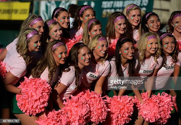 The CSU Rams Dance Team poses for photos before the Border War game against Wyoming at Sonny Lubick Field at Hughes Stadium Saturday evening October...