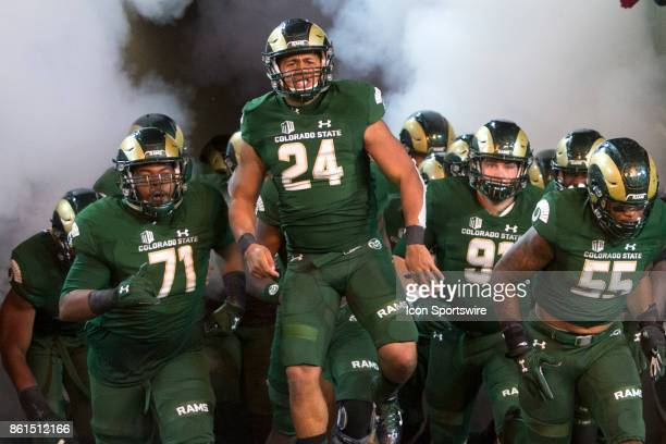 The CSU Rams take the field during the UNR at CSU football game at Sonny Lubick Field at Hughes Stadium in Fort Collins Colorado on October 14 2017
