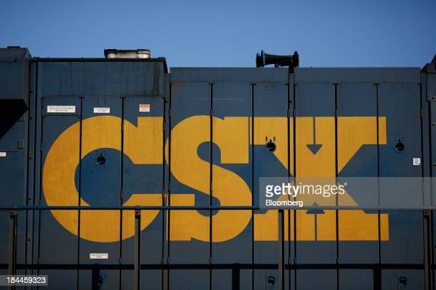 The CSX Corp logo is seen painted on the side of a General Electric GEES44DC GEVO locomotive on the siding at Campbellsburg Kentucky US on Friday Oct...