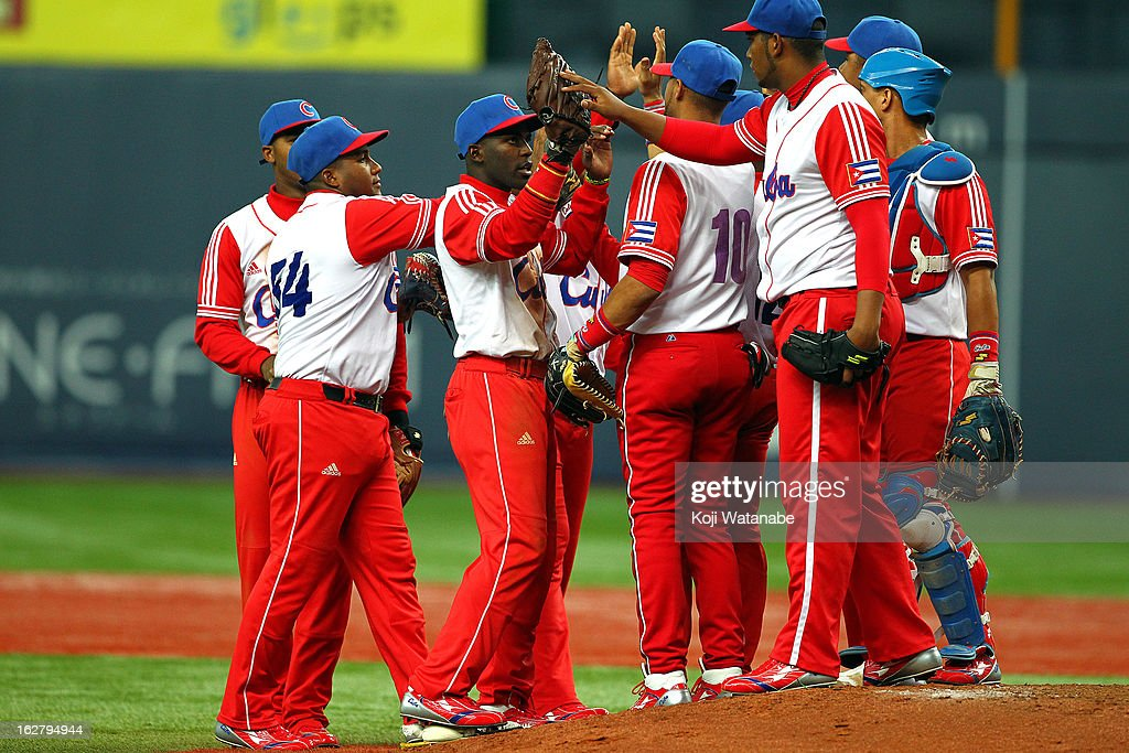 The Cuba team celebrates their win after the friendly game between Hanshin Tigers and Cuba at Kyocera Dome Osaka on February 27, 2013 in Osaka, Japan.