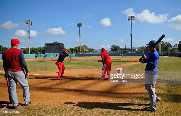The Cuban national baseball team trains at the Latinoamericano stadium in Havana on March 13 2016 Cubans look forward to the baseball game between...