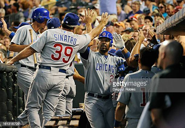 The Cubs dugout congratulates firstbaseman Derrek Lee after tying the game at 55 with a threerun bomb in the top of the eighth inning The Colorado...