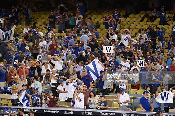 The Cubs fans hold up their 'W' banners to celebrate the victory during game four of the National League Championship Series between the Chicago Cubs...