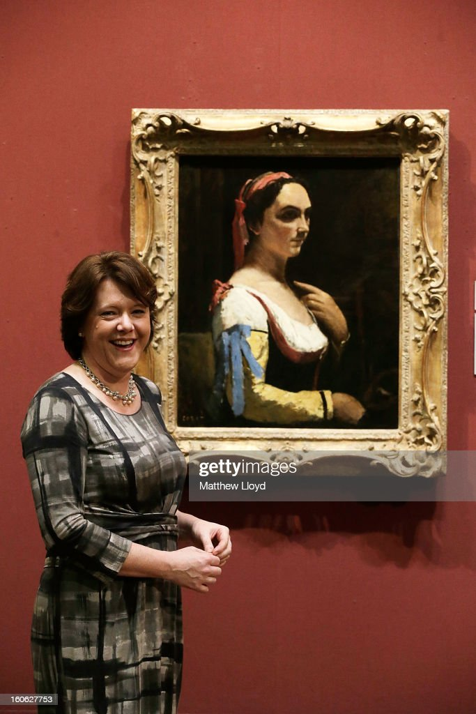 The Culture Secretary Maria Miller poses for photographs in front of 'L'Italienne ou La Femme a la Manche Jaune' by French artist Jean-Baptiste Camille Corot on February 4, 2013 in London, England. The artwork has been permanently allocated to the National Gallery for public exhbition by the estate of Lucian Freud.