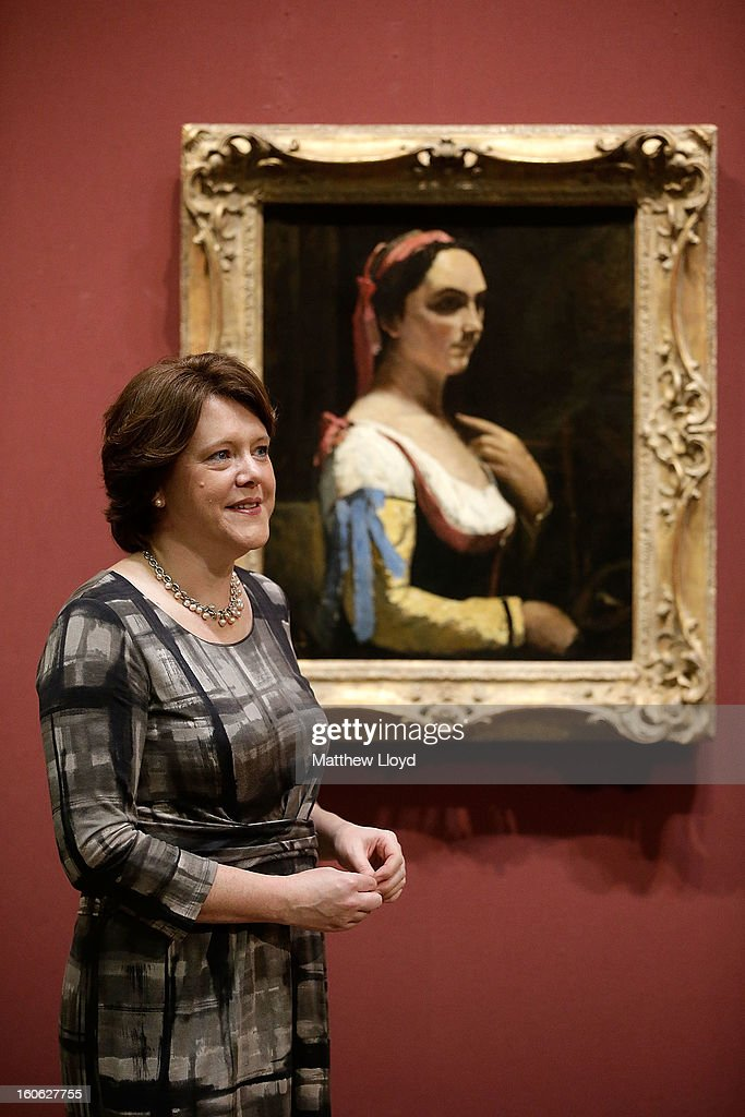 The Culture Secretary Maria Miller poses for photographs in front of 'L'Italienne ou La Femme a la Manche Jaune' by French artist Jean-Baptiste Camille Corot on February 4, 2013 in London, England. The artwork has been permanently allocated to the National Gallery for public exhibition by the estate of Lucian Freud.