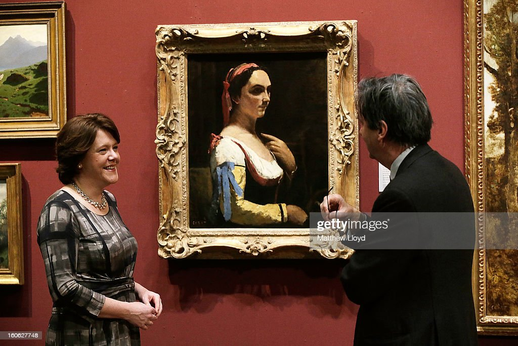 The Culture Secretary Maria Miller talks to Dr Nicholas Penny, Director of the National Gallery in front of 'L'Italienne ou La Femme a la Manche Jaune' by French artist Jean-Baptiste Camille Corot on February 4, 2013 in London, England. The artwork has been permanently allocated to the National Gallery for public exhbition by the estate of Lucian Freud.