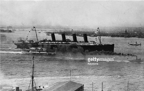 The Cunard liner Lusitania one of only 14 fourstackers ever built steaming into New York harbour She was torpedoed by a German submarine off the...