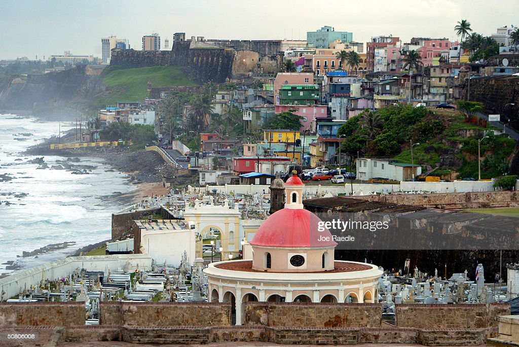 The cupola of San Juan Cemetary as well as colorful homes sit next to the ocean April 26 2004 in Old San Juan the original capital city of San Juan...