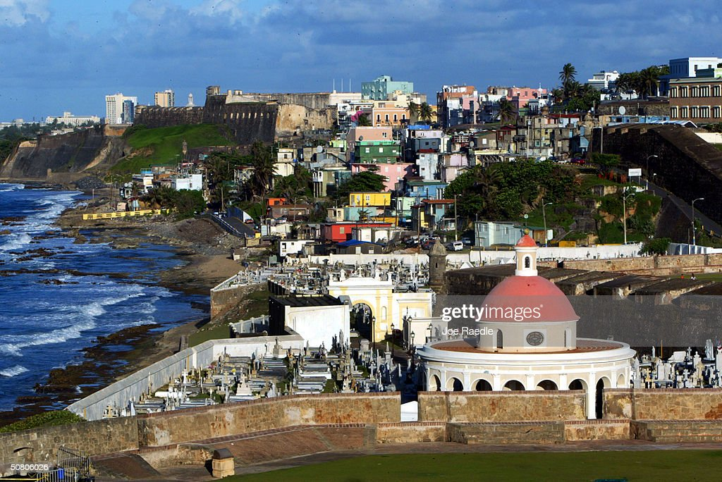 The cupola of San Juan Cemetary as well as colorful homes sit next to the ocean April 25 2004 in Old San Juan the original capital city of San Juan...