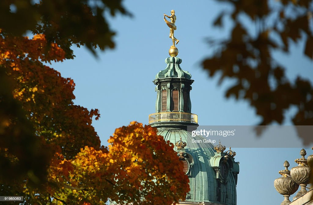 The cupola of Schloss Charlottenburg palace is visible behind autumn trees on October 19 2009 in Berlin Germany Fall has reached Germany with...