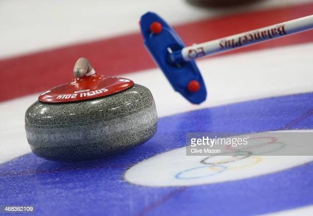 The curling stone is pictured on the ice sheet during day 3 of the Sochi 2014 Winter Olympics at Ice Cube Curling Center on February 10 2014 in Sochi...