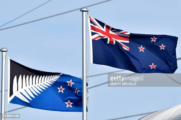 The current New Zealand flag flutters next to the alternative flag in Wellington on March 4 2016 New Zealanders began voting on March 3 on whether to...