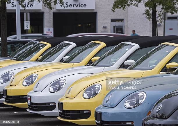 The current version of the Volkswagen Beatle automobiles are lined up for sale at Northern Virginia dealer in Woodbridge Virginia on September 29...