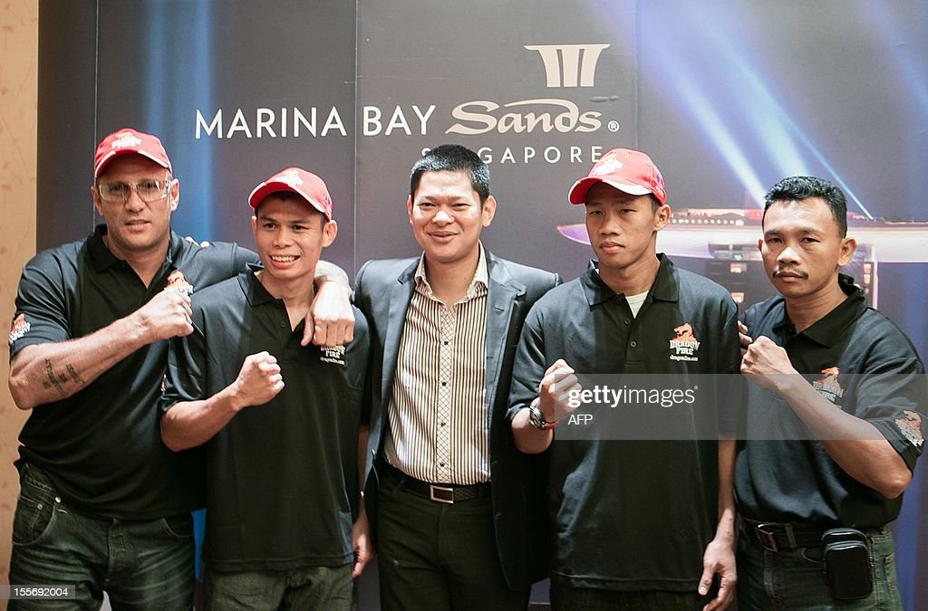 "The current WBO and IBO Featherweight Champions Chris John (2nd L) with his coach (L), Raja Sapta Oktohari (C),Indonesian boxer Daud Yordan (2nd R) and his coach (R) pose for photographers during the Dragonfire World Championship Boxing 2012 press conference in Singapore on November 7, 2012. Indonesian superstar and current undefeated WBA Super World Featherweight Boxing Champion Chris ""The Dragon"" John returns to defend his belt against the undefeated Chonlatarn Piriyapinyo from Thailand on November 9 in Singapore."