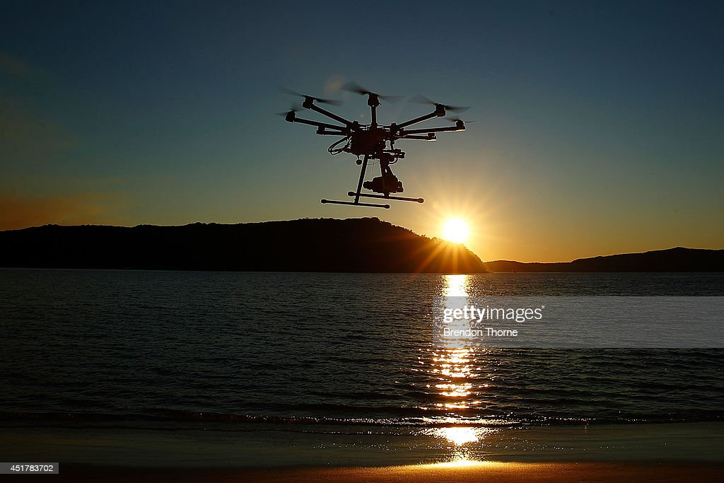 The custom built DJI s1000 Drone in operation at Palm Beach on July 4, 2014 in Sydney, Australia. Commercial and recreational UAV (Unmanned Aerial Vehicles) sales in Australia have regulators concerned about safety, privacy and security, while the commercial industries of mining, farming, property, and sport are embracing the new technology. Under the current CASA (Civil Aviation Safety Authority) regulations all unmanned aircraft weighing more than 2kg need to have a UAS operators certificate. Licensed operators are not allowed to fly above 400ft, not within 5km of an airfield boundary and can't fly within 30 metres of people not involved with the operation.