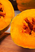 The cut part of the orange pumpkin with fibers in the middle.