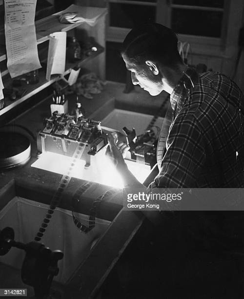 The cutter splicing film for a new animated feature film produced by J Arthur Rank the first film of its kind to be made in Britain