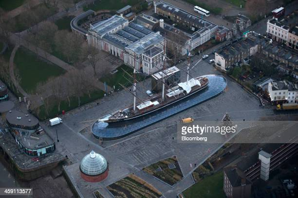 The Cutty Sark a restored 19th century sailing ship and popular tourist attraction stands encased in glass in this aerial photograph taken over...