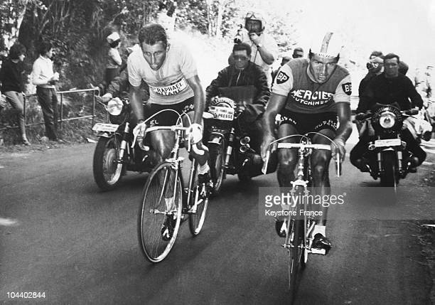 The cyclists ANQUETIL and POULIDOR wheel to wheel during the climb up Puy de Dôme in the BriveClermont Ferrand stage of the 1964 Tour de France...