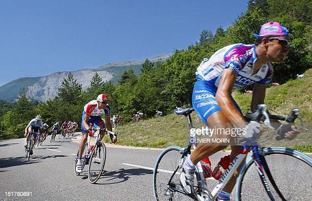 The cyclists of the 89th Tour de France ride together during the 15th stage of the French cycling race between VaisonlaRomaine and Les DeuxAlpes 23...