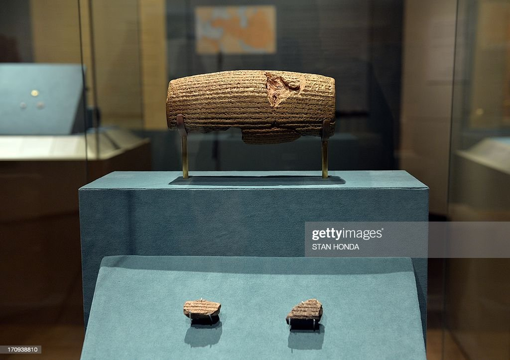 The Cyrus Cylinder, Achaemenid, 539-538 B.C., excavated at Babylon, Iraq, 1879, on display with fragments of table with Babylonia cuneiform inscription (bottom), Achaemenid, 539-538 B.C. in 'The Cyrus Cylinder and Ancient Persia: Charting a New Empire' June 20, 2013 at The Metropolitan Museum of Art in New York. The Cyrus Cylinder is a 2,600-year-old inscribed clay document from Babylon in ancient Iraq and one of the most famous surviving icons from the ancient world is part of a traveling exhibition organized by the British Museum. The Cylinder marks the establishment of Persian rule in 539 B.C. by Cyrus the Great, with the defeat of Babylon, the restoration of shrines, and the return of deported peoples and their gods. The Cyrus Cylinder and 16 related works on view, all on loan from the British Museum, reflect the innovations initiated by Persian rule in the ancient Near East (550331 B.C.) and chart a new path for this empire, the largest the world had known. AFP PHOTO/Stan HONDA