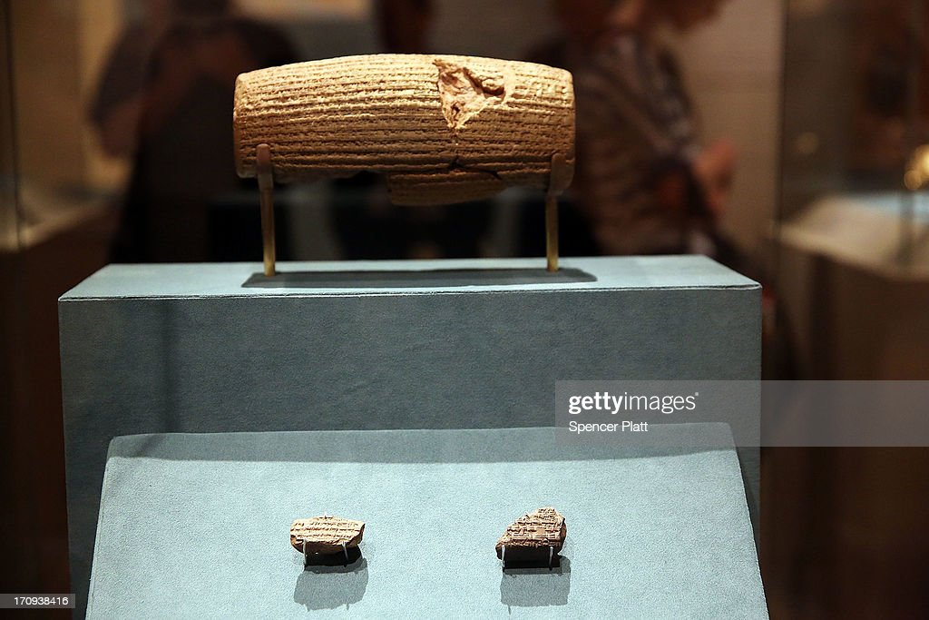 The Cyrus Cylinder-a 2,600-year-old inscribed clay document from Babylon in ancient Iraq-is viewed at The Metropolitan Museum of Art on June 20, 2013 in New York City. One of the most famous surviving icons from the ancient world, the Cyrus Cylinder is the centerpiece of the traveling exhibition The Cyrus Cylinder and Ancient Persia: Charting a New Empire.