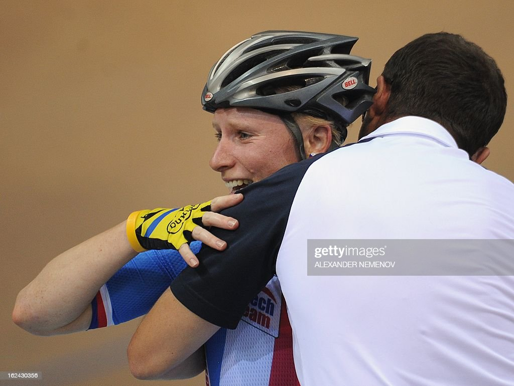 The Czech coach kisses Jarmila Machacova, as she won the Womens' 25 km Point Race event of the UCI Track Cycling World Championships in Minsk on February 23, 2013.