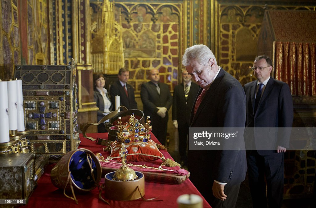 The Czech President <a gi-track='captionPersonalityLinkClicked' href=/galleries/search?phrase=Milos+Zeman&family=editorial&specificpeople=2595776 ng-click='$event.stopPropagation()'>Milos Zeman</a> looks at the Czech Crown Jewels before the opening of The Bohemian Crown Jewels Exhibition 2013 on May 9, 2013 in Prague, Czech Republic. The Czech jewels and Crown of Saint Wenceslas are considered some of the oldest in Europe and are displayed to the public once every five years. Vladislav's Hall will exhibit the jewels at the Prague Castle from May 10 to 19.