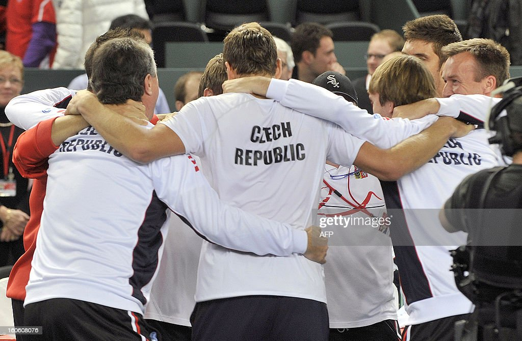 The Czech Republic team celebrate after winning their Davis Cup World Group first round tennis match against Switzerland on February 3, 2013 in Geneva.