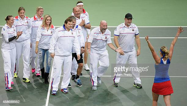 The Czech Republic team congratulates Petra Kvitova of the Czech Republic after victory in the third rubber and winning the the Fed Cup after her...