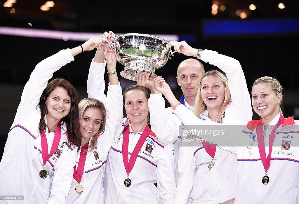 The Czech Republic team including Petr Pala Team Captain, Petra Kvitova, Lucie Safarova, <a gi-track='captionPersonalityLinkClicked' href=/galleries/search?phrase=Andrea+Hlavackova&family=editorial&specificpeople=3378910 ng-click='$event.stopPropagation()'>Andrea Hlavackova</a>, <a gi-track='captionPersonalityLinkClicked' href=/galleries/search?phrase=Lucie+Hradecka&family=editorial&specificpeople=4882302 ng-click='$event.stopPropagation()'>Lucie Hradecka</a> and <a gi-track='captionPersonalityLinkClicked' href=/galleries/search?phrase=Karolina+Pliskova&family=editorial&specificpeople=6705229 ng-click='$event.stopPropagation()'>Karolina Pliskova</a> celebrate with the Fed Cup after victory over Germany in the Fed Cup Final on November 9, 2014 in Prague, Czech Republic.