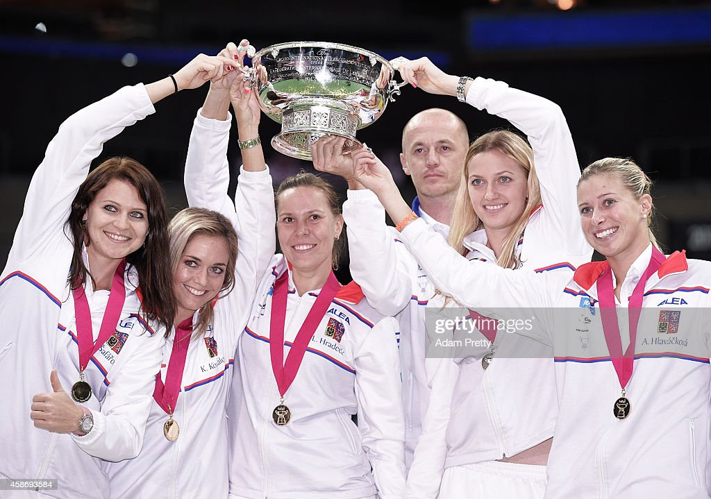 The Czech Republic team including Petr Pala Team Captain, Petra Kvitova, Lucie Safarova, <a gi-track='captionPersonalityLinkClicked' href=/galleries/search?phrase=Andrea+Hlavackova&family=editorial&specificpeople=3378910 ng-click='$event.stopPropagation()'>Andrea Hlavackova</a>, <a gi-track='captionPersonalityLinkClicked' href=/galleries/search?phrase=Lucie+Hradecka&family=editorial&specificpeople=4882302 ng-click='$event.stopPropagation()'>Lucie Hradecka</a> and Klara Koukalova celebrate with the Fed Cup after victory over Germany in the Fed Cup Final on November 9, 2014 in Prague, Czech Republic.