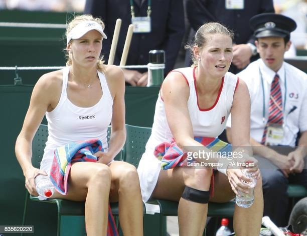 The Czech Republic's Nicole Vaidisova and Eva Hrdinova take a break during their match against USA's Julie Ditty and Belarus' Ekaterina Dzehalevich...