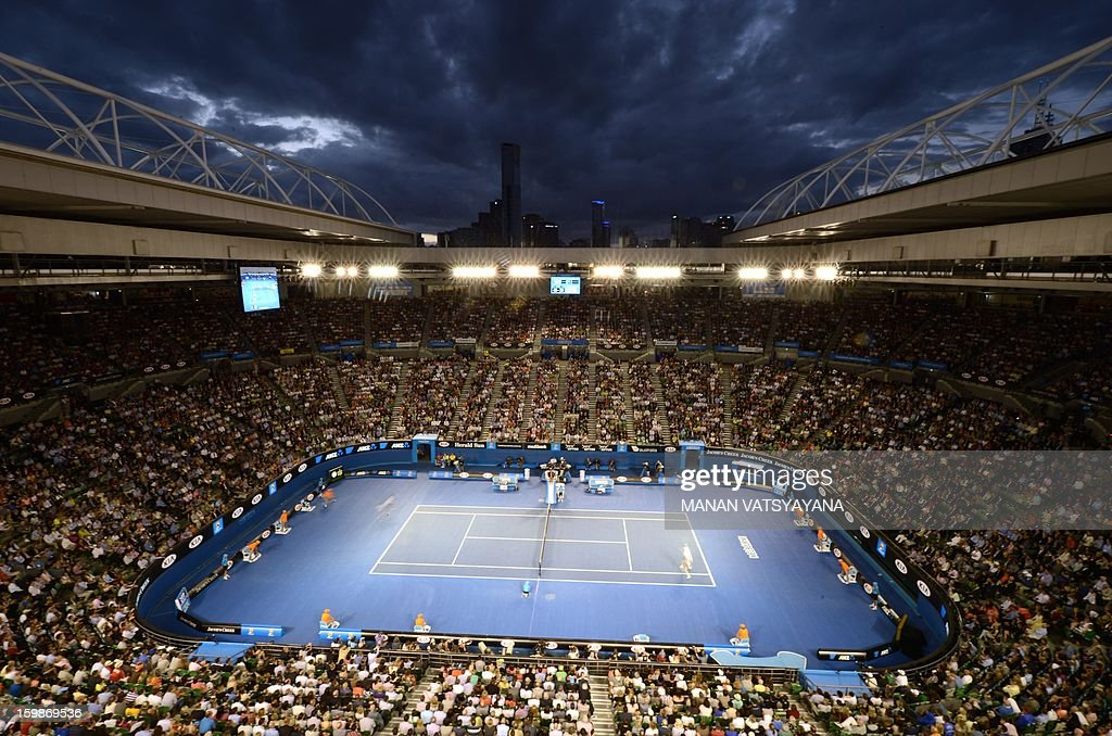 The Czech Republic's Tomas Berdych (R) hits a return against Serbia's Novak Djokovic during their men's singles match on day nine of the Australian Open tennis tournament in Melbourne on January 22, 2013.