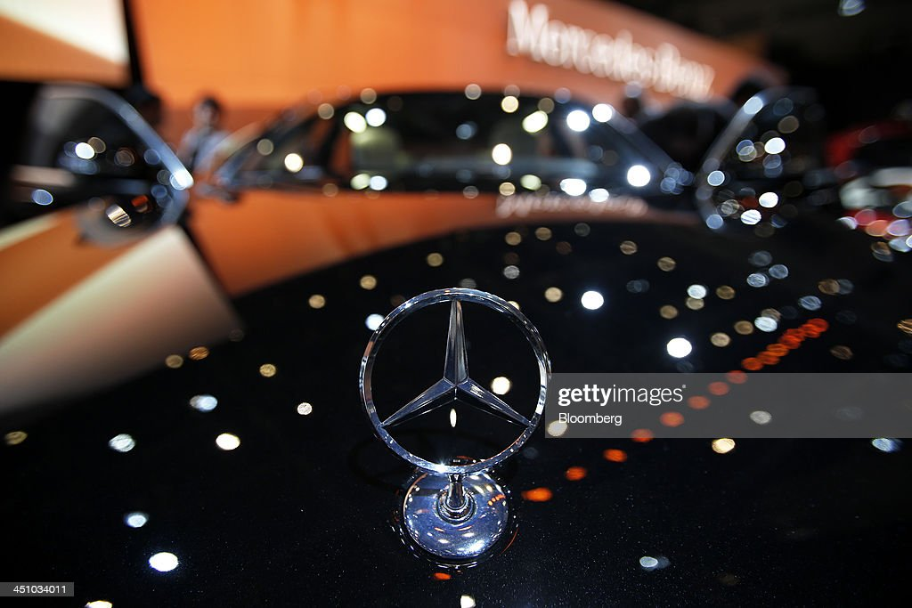 The Daimler AG Mercedes-Benz emblem sits on the hood of the S 65 AMG long vehicle at the 43rd Tokyo Motor Show 2013 in Tokyo, Japan, on Thursday, Nov. 21, 2013. The autoshow will be open to the public from Nov. 23 to Dec. 1 at the Tokyo International Exhibition Center, also known as the Tokyo Big Sight. Photographer: Kiyoshi Ota/Bloomberg via Getty Images
