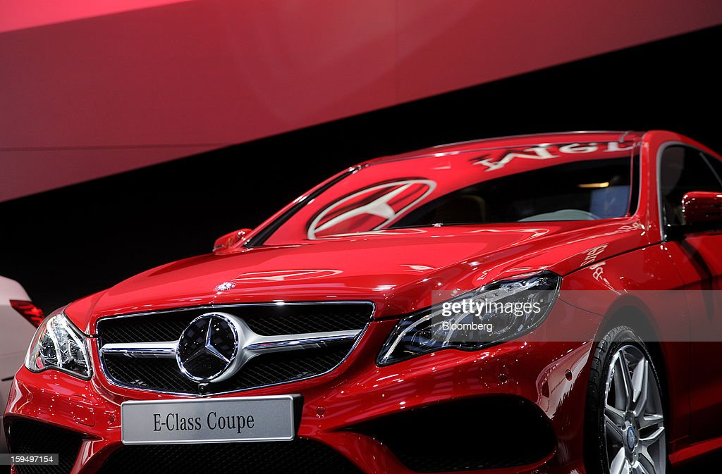 The Daimler AG Mercedes-Benz logo E-Class Coupe vehicle is displayed during the 2013 North American International Auto Show (NAIAS) in Detroit, Michigan, U.S., on Monday, Jan. 14, 2013. The Detroit auto show runs through Jan. 27 and will display over 500 vehicles, representing the most innovative designs in the world. Photographer: Daniel Acker/Bloomberg via Getty Images
