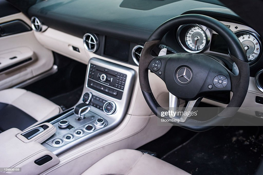 The Daimler AG Mercedes-Benz logo is displayed on the steering wheel of a Mercedes-Benz SLS AMG Roadster vehicle inside the newly opened T&T Motors Ltd. Mercedes-Benz India flagship dealership in New Delhi, India, on Saturday, Jan. 19, 2013. The Indian Finance Ministry projects Asia's third-largest economy will expand as little as 5.7 percent in the 12 months to March 31, which would be the weakest pace in a decade. Photographer: Sanjit Das/Bloomberg via Getty Images