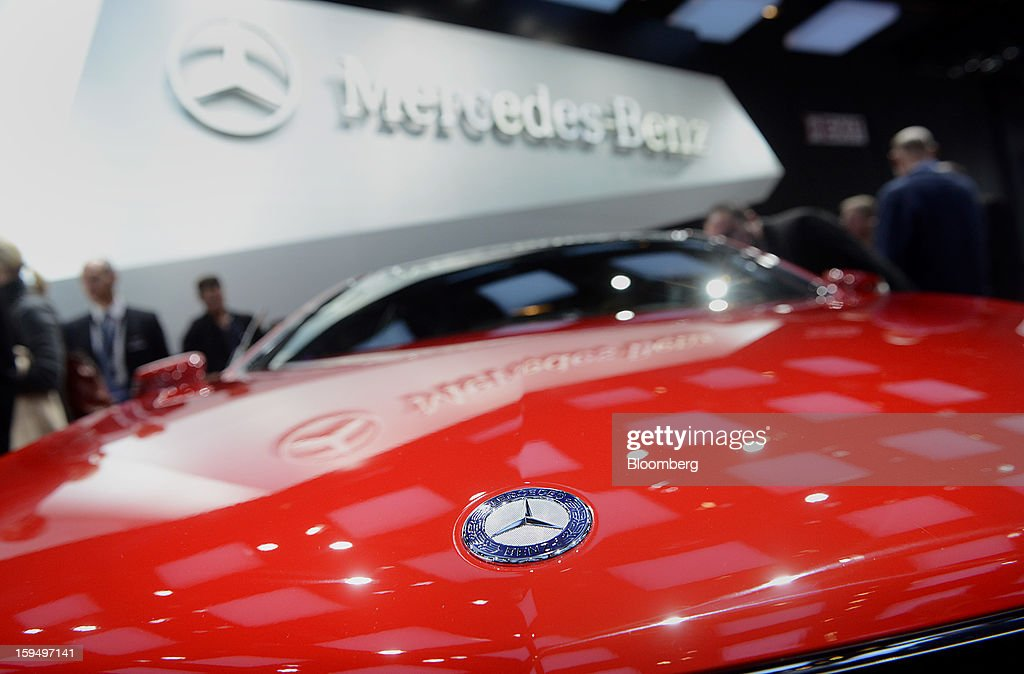 The Daimler AG Mercedes-Benz logo is seen on an E-Class Coupe vehicle during the 2013 North American International Auto Show (NAIAS) in Detroit, Michigan, U.S., on Monday, Jan. 14, 2013. The Detroit auto show runs through Jan. 27 and will display over 500 vehicles, representing the most innovative designs in the world. Photographer: Daniel Acker/Bloomberg via Getty Images