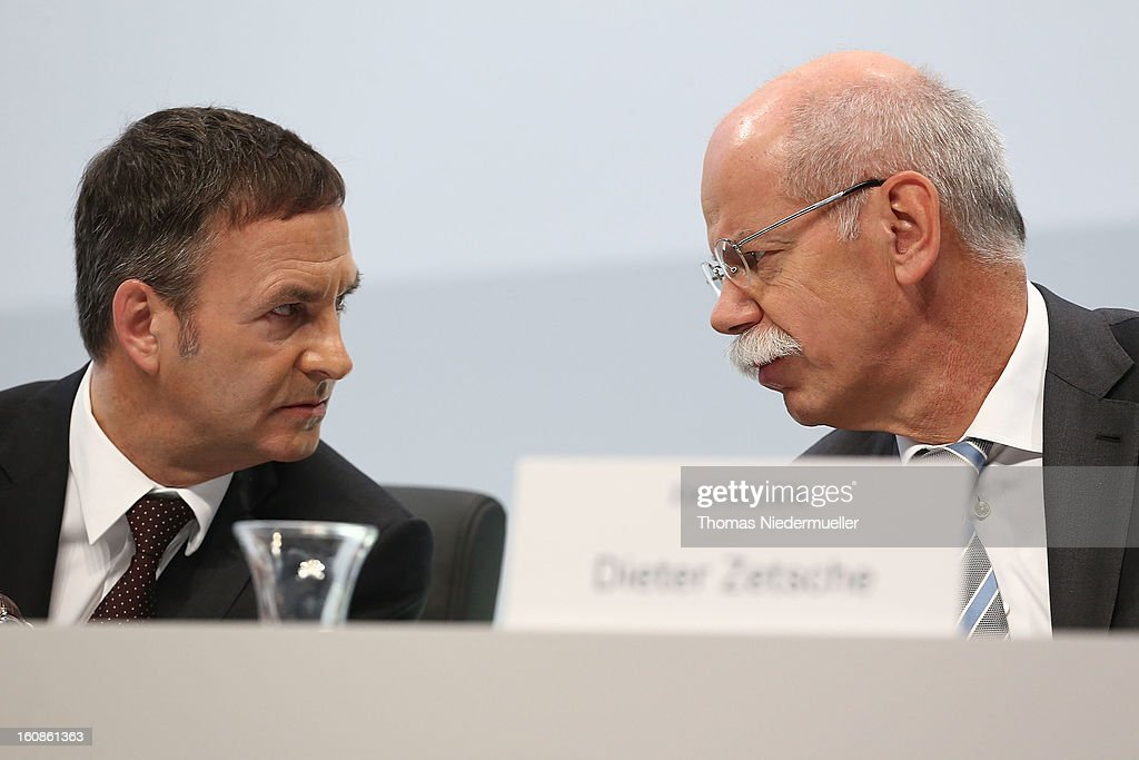 The Daimler Board of Directors Bodo Uebber (L) and CEO of Daimler AG, <a gi-track='captionPersonalityLinkClicked' href=/galleries/search?phrase=Dieter+Zetsche&family=editorial&specificpeople=241297 ng-click='$event.stopPropagation()'>Dieter Zetsche</a> are seen the company's financial performance in 2012 during the Daimler AG, annual press conference on February 7, 2013 in Stuttgart, Germany. Daimler, which manufactures Mercedes-Benz luxury cars, finished in 2012 with its highest business volume of 114.3 Billion Euro since ending its merger with Chrysler in 2007. The group announced a EBIT from ongoing business of 8.6 Billion Euro.