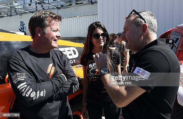 The Dakar Rally director Etienne Lavigne speaks with Hummer's driver US Robby Gordon at the technical area of the Dakar Rally in Buenos Aires...