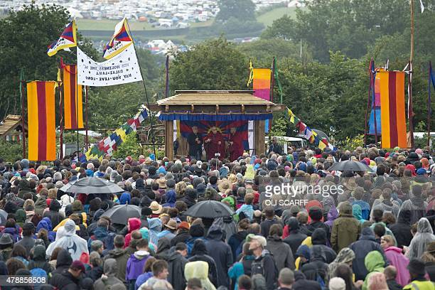 The Dalai Lama addresses an audience near the Stone Circle as he visits the Glastonbury Festival of Music and Performing Arts on Worthy Farm near the...