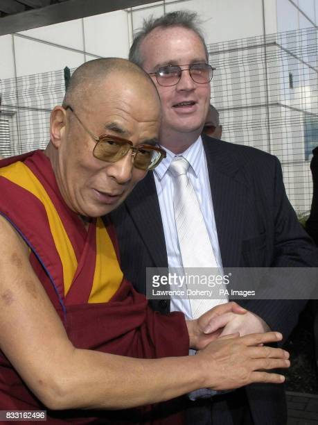 The Dalai Lama arrives at the City of Derry Airport in County Derry Ireland with Richard Moore the MD of a charity called Children In Crossfire with...