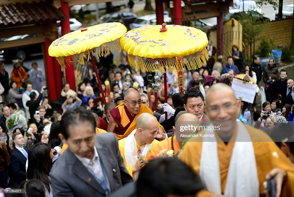 The Dalai Lama arrives to speak to his supporters at the Vien-Giac Pagoda monastery on September 20, 2013 in Hanover, Germany. His Holiness will travel next to India.