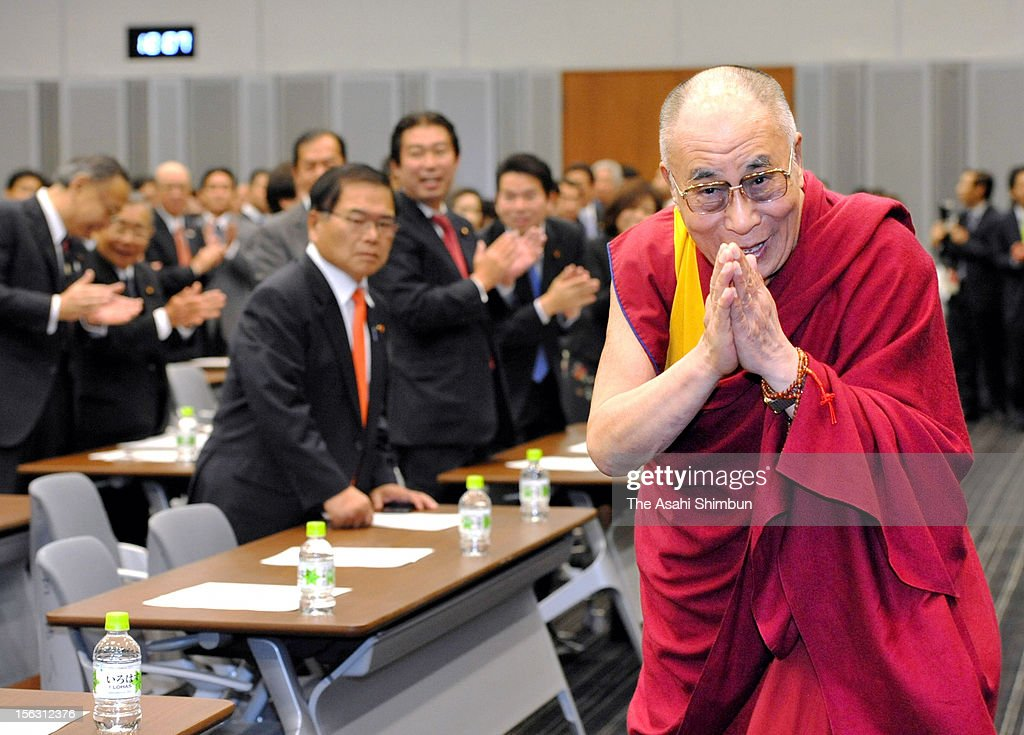 The Dalai Lama bows after addressing in front of the lawmakers at the upper house lawmakers buidling on November 13, 2012 in Tokyo, Japan. Opposition Liberal Democratic Party leader Shinzo Abe attends the lecture.