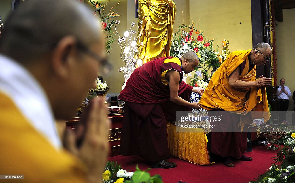 The Dalai Lama bows before he speaks to his supporters at the Vien-Giac Pagoda monastery on September 20, 2013 in Hanover, Germany. His Holiness will travel next to India.