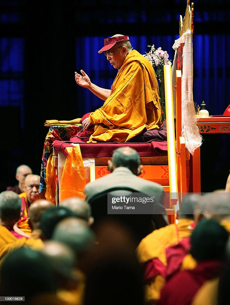 The Dalai Lama delivers a teaching at Radio City Music Hall as Buddhist monks look on May 20, 2010 in New York City. The Tibetan spiritual leader will deliver three days of teachings at Radio City followed by an interfaith dialogue at the Church of St. John the Divine on Sunday.
