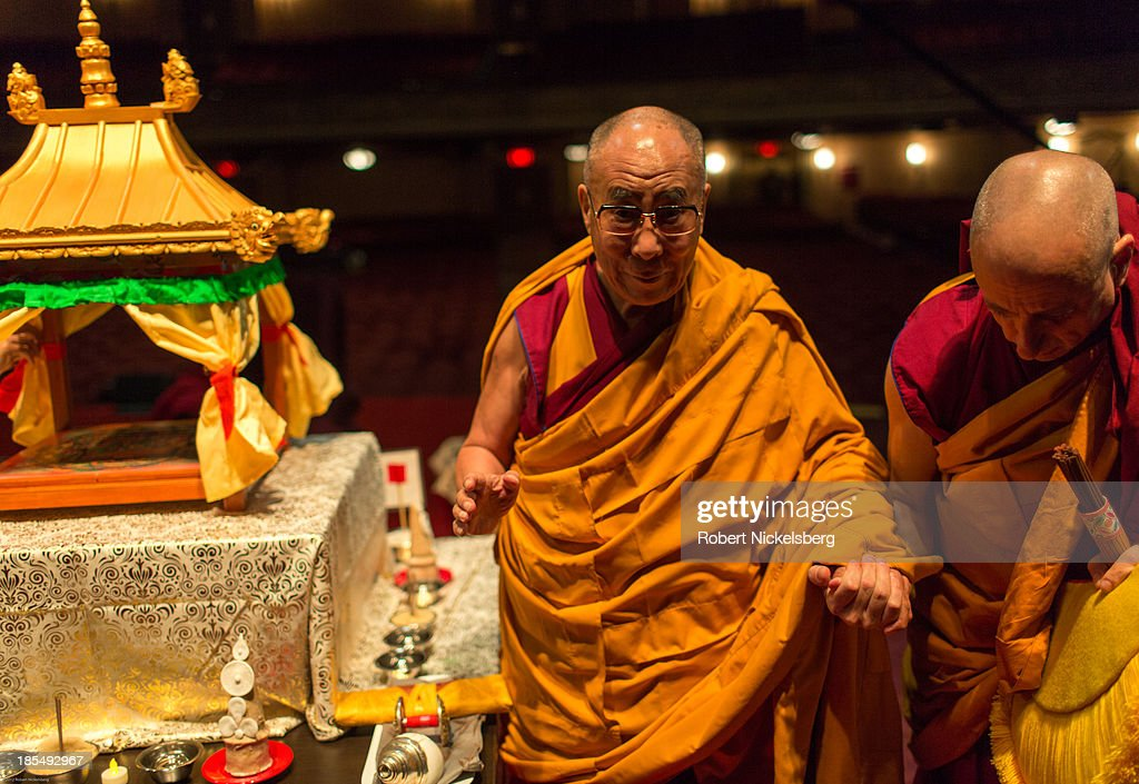 The Dalai Lama departs the stage following an initiation ceremony at the Beacon Theater October 20, 2013 in New York City. His Hliness is accompanied by Buddhist monk Nicholas Vreeland (R).The Dalai Lama is in New York City for three days of his Buddhist teachings that run October 18-20. The teachings are supported by the Richard Gere Foundation.